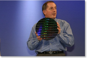 Intel CEO Paul Otellini holds a silicon wafer