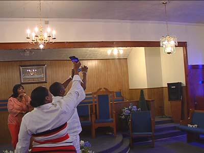 Churchgoerâ??s photograph lights; see God, claim miracle.